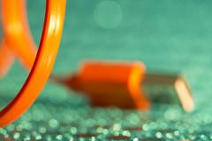 Buried in bokeh (alideniese) Tags: macromondays plugsandjacks 7dwf anythinggoesmondays macro closeup bokeh plug cable mobilephonecharger colour colourful bright green orange metal plastic alideniese