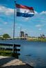 very windy in Kinderdijk (swissgoldeneagle) Tags: zuidholland nederwaard molenwaard südholland southholland rx100m4 fahne flag sony alblasserwaard sonycamera rx100 kinderdijk alblasserdam niederlande nl netherlands nederland