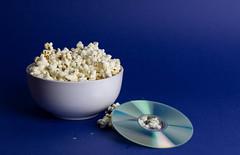 Popcorn and DVD (wuestenigel) Tags: popcorn corn bowl food dvd studio movie salted noperson keineperson desktop stilllife stillleben