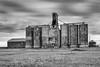 Industry in the Grasslands. (dshoning) Tags: kansas grain silos elevator farming bw