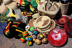 Come Gimme a Look,Mon! (Poocher7) Tags: jamaica montegobay mobay caribbean market souvenirs strawgoods strawhats steelpan steeldrums morrocas jamaicanflag hats reggaecolours sundaylights shopping