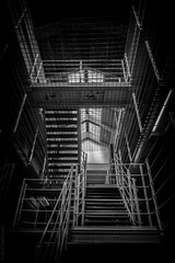 stairs and bars (D-j-L) Tags: scotland unitedkingdom gb peterhead aberdeenshire peterheadconvictprison peterheadprisonmuseum prison jail gaol museum stairs staircase bars grid bw monochrome blackandwhite inside indoors canon g7x g7xmarkii