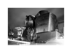 A masterpiece of the 20th c. 11 (2 Marvelous 4 Words (Blanca Gomez)) Tags: bilbao spain museum guggenheimmuseum museo arquitectura architecture building masterpiece artgallery arts workofart frankgehry thomaskrens bw blackwhite deconstructivism glass limestone titanium