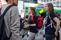 Backpacking Tourists (burnt dirt) Tags: asian japan tokyo shibuya station streetphotography documentary candid portrait fujifilm xt1 laugh smile cute sexy latina young girl woman japanese korean thai dress skirt shorts jeans jacket leather pants boots heels stilettos bra stockings tights yogapants leggings couple lovers friends longhair shorthair ponytail cellphone glasses sunglasses blonde brunette redhead tattoo model train bus busstation metro city town downtown sidewalk pretty beautiful selfie fashion pregnant sweater people person costume cosplay backpack red black tourist camera
