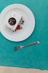 MisŽrable cake. (annick vanderschelden) Tags: mother sugar powdersugar chocolate rose decoration flower leaf misžrable gray blue belgian plate pastry food bakery fork misérable