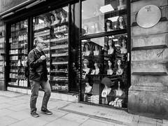 Northern Quarter 209 (Peter.Bartlett) Tags: manchester bag niksilverefex shopfront window unitedkingdom people city olympuspenf walking urbanarte cigarette noiretblanc peterbartlett man urban streetphotography monochrome uk m43 microfourthirds shopwindow bw reflection sign blackandwhite candid facade england gb