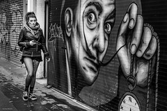 Hypnotized by Dali (Silver Machine) Tags: london streetphotography street graffiti salvadordali zabou girl walking leatherjacket outdoor people blackwhite bw mono monochrome fujifilm fujifilmxt10 fujinonxf35mmf2rwr