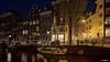 Amsterdam. (alamsterdam) Tags: amsterdam longexposure canal architecture reflection shop bikes cars groenburgwal bridge