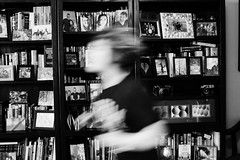 Quick (RubyT (I come here for cameraderie!)) Tags: qforquick 52project pentaxkp f3570 girl running books bookcase bw nb bn mono monocromo monochrome blackandwhite schwarzweiss noirblanc blancoynegro черноеибелое