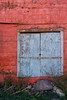 Blue Shutter (Perry J. Resnick) Tags: pjresnick perryjresnick pjresnickgmailcom pjresnickphotographygmailcom ©2018pjresnick ©pjresnick light fuji fujifilm atmosphere atmospheric digital shadow texture shadows naturallight white xf fujinon resnick rectangle rectangular xpro2 fujifilmxpro2 16mm fujinon16mmf14 fuji16mm building structure wall taos newmexico 4x6 color colour blue orange brown ranchosdetaos red rock rocks weeds weed shutter window overgrown metalsiding metalwall