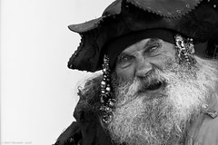Shiver Me Timbers! (Neil. Moralee) Tags: neilmoralee piratebrixhamneilmoralee man old mature pirate costume hat beard tricorn black white bw bandw blackandwhite mono festival brixham devon uk face portrait street close nikon d7200 neil moralee 2018 sea shanty salty captain fierce dangerous buckaneer shivermetimbers bead braids fun scowl galleon