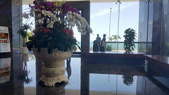 CHecking out (Roving I) Tags: checkout flowers displays foywers decor reflections windows shine hotels hospitality tourism travel lifestyle leisure mice botonblue nhatrang vietnam
