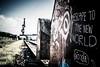 Escape to the new World (blende9komma6) Tags: hannover linden germany nikon d7100 escape graffiti urban hafen port harbor entkommen rails vessel water street art world welt erde