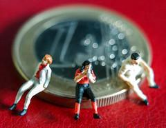 Sitting On Money (ricky2m_1974) Tags: euro little people minature coin macro world nano dreams bokeh