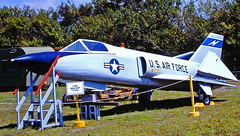 USAF F-106 Delta Dart, No. 560966, Clearwater Aircraft Museum, Clearwater, Florida (gg1electrice60) Tags: f106 deltadart allweatherinterceptor usaf560966 usafnumber560966 usafno560966 clearwaterstpetersburgairport rooseveltboulevard rooseveltblvd florida fl unitedstates usa us america hangerclub fauxvillage fakevillage militaryplanes oldmilitaryplanes aircraft airplanes baysidebridge 49thstreet fortyninthst twinengines dualengines jetaircraft smallplanes jetplane nearuscoastguardstation usairforceplanes starlogo usairforceaircraft foldingwings canopy 13scalemodel sign placard informationsign vietnameraaircraft manufacturedbycorvair