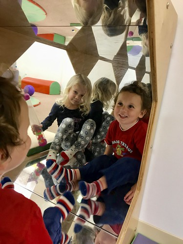 The twins looking into a mirror today at the kid's club