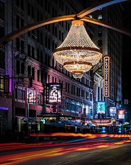 The Jewel Of Playhouse Square (Wes Iversen) Tags: cleveland clichesaturday hcs nikkor24120mm ohio playhousesquare architecture chandelier cities lighttrails lights longexposure night signs theatredistrict theatres