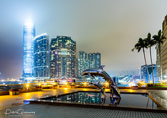 Leaping Dolphin Statues At Kowloon Harbour (Peter Greenway) Tags: skyscrapers hongkong nightlights urban kowloon night flickr nightphotography hk skyline offices officeblocks nighttime