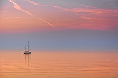 Stay Until The Sun Is Away (Alfred Grupstra) Tags: sunset sea nature nauticalvessel beach water tranquilscene reflection dusk summer sky coastline outdoors landscape sailboat sunlight scenics sun sunrisedawn vacations 97