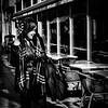 Sassy shade (Kieron Ellis) Tags: street candid woman scarf phone cafe chairs tables windows smile blackandwhite blackwhite monochrome