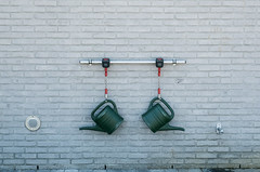 Hanging around (Georgie Pauwels) Tags: wall cans watercans minimal geometry street streetphotography symetry fujifilm minimalism