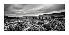 Ribblehead Viaduct Long Exposure (Dave Slinn) Tags: ribbleheadviaduct ribblehead ribblesdale yorkshiredales yorkshire settlecarlisleline viaduct limestone clouds longexposure blackandwhite mono panorama