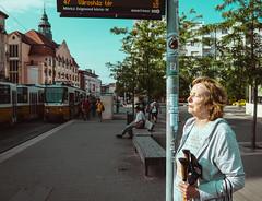 instant sunbathing (taxtamas) Tags: sunbathing woman lady budapest hungary city street people tram