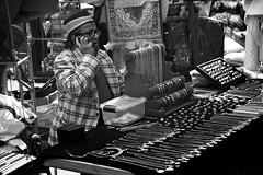 Bangles in the Market (garryknight) Tags: sony a6000 on1photoraw2018 london copyright allrightsreserved whitechapel blackandwhite monochrome mono themonoseries bangle necklace bracelet jewelry jewellery market stall stallholder man