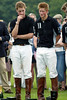 Prince William (L) and brother Prince Harry (R) wait to receive their prizes at the end of the Calcot Manor Hotel polo cup on June 22, 2003 at Tetbury, Gloucestershire. (Photo by Getty Images)