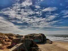 Coastal battery embellished with graffiti (Friedels Foto Freuden) Tags: clouds himmel bunker houvig dänemark strand