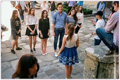 Teenagers are preparing some kind of street scene. (Ігор Кириловський) Tags: c41 135 lviv ukraine viewfinder agfaoptima1035sensor agfa film fujifilm fujicolorc200 hoyauv0 markstudiolab chernivtsi teenagers streetscene kirilovskiigor kyrylovsky agfasolitars40mmf28