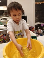 Liam filling a jar with water (avlxyz) Tags: liam lfb science water