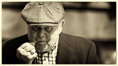 Winkles and pins. (Neil. Moralee) Tags: beerdevonneilmoraleesigma150500 neilmoralee man hat old mature eating stare winkles winkle sea food pin sepia toned portrait face neil moralee nikon d7200 sigma 150500 beer devon uk cockes muscles welks prawn crab fish tradition traditional ocean fisheman black white bw blackandwhite mono monochrome telephoto enjoyment eyes
