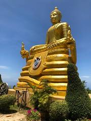 Golden statue (BiggestWoo) Tags: hot holiday religion gold blue sky sun bhuddism statue thailand phuket chalong bhudda big