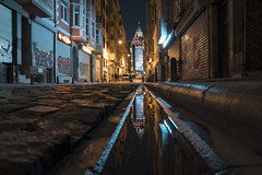 Reflection of Galata Tower (WeekendPlayer) Tags: reflection lowangle angle low flickr flickrfriday street night lights light water side walk sidewalk people building galata tower longexpsoure long exposure stone road istanbul city streets car