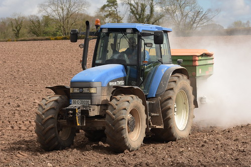 New Holland TM150 Tractor with an Amazone Z-AM 1500 Fertilizer