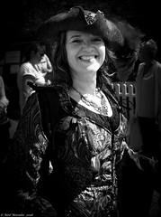 Lady Pirates did exist. (Neil. Moralee) Tags: neilmoralee piratebrixhamneilmoralee lady woman pirate girl bright smile mature hat bodice black white bw bandw blackandwhite brixham 2018 festival uk britain necklace law order criminal neil moralee nikon d7200 street happy costume people mono monochrome face portrait close