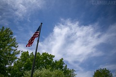 American Skies (ClamBlake) Tags: landscape landscapephotography sky clouds trees america americanflag flag skyline outdoor park sunshine red white blue green woodstock illinois nikon nikond3400
