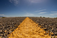 The Yellow Line (Karen_Chappell) Tags: road yellow paint painted line asphalt pavement blue brown usa travel utah bonnevillesaltflats wideangle fisheye canonef815mmf4lfisheyeusm landscape sky ground