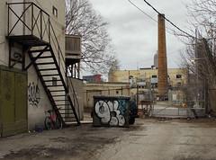 (geowelch) Tags: toronto libertyvillage urbanlandscape yard smokestack chimney industriallandscape buildings fireescape dumpster microfourthirds olympusomdem5 panasoniclumixgvario1445mm