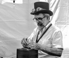 Tinkerer (clarkcg photography) Tags: man male gray steampunk tinker tinkerer blackandwhite blackwhite bw mayfest tulsa oklahoma 7dwf