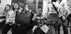 Slice of life. (Baz 120) Tags: candid candidstreet candidportrait city candidface candidphotography contrast street streetphoto streetphotography streetcandid streetportrait sony a7 fullframe rome roma romepeople romestreets europe women monochrome mono monotone noiretblanc bw blackandwhite urban life primelens portrait people pentax20mm28 italy italia girl grittystreetphotography faces decisivemoment strangers