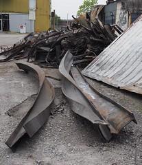 050418fsj-10a (djfnola) Tags: davidfischer olympus mzuiko1240mm28pro fsj faubourgstjohn neworleans la louisiana fire scene details warehouse canalfurnitureliquidators twisted steel beams