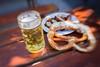 Beer Garden Weather (suzanne~) Tags: beer pretzel brezen spareribs table food outdoor beergarden munich bavaria germany lensbaby sweet35
