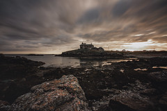 The Scary House. [Explored] (Simon Rich Photography) Tags: anglesey wales sun sunset scary houcs seascape landscape long exposure house water sea calm still detail rocks coastline coast cloud movement simonrich simonrichphotography mrmonts canon