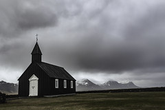 The Black Church on the Peninsula (jessicalowell20) Tags: adventure black blackchurch clouds europe flield grass gray green iceland landscape may mountains noperson northatlanticocean snaefellspeninsula spring summer travel westiceland white budir dramatic sky