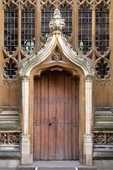 North doorway, Divinity School, 1483, University of Oxford, England. (edk7) Tags: nikoncoolpix4500 edk7 2007 uk england oxfordshire oxford universityofoxford divinityschool medieval building williamorchard gothicperpendicular 1483 architecture oldstructure stonecarving stone stonework sculpture museum door wood window glass leading tracery column arch boss
