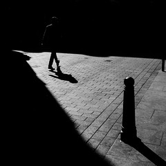 In The Zone (Sean Batten) Tags: london england uk europe soho blackandwhite bw streetphotography street light shadow pavement nikon d800 35mm city urban person bollard chinatown