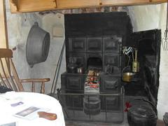 A cosy room (bryanilona) Tags: martingdale rockhouse kinver cave sandstone bath fire table beam interior livingroom holyaustin cookingrange openfire pans fireguard flatirons