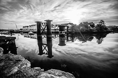 The old railway bridge (NikNak Allen) Tags: plymouth plympton hooe turnchapel hooelake river sea water stone trees houses sky clouds sun sunrise early morning reflection grey black white blackandwhite longexposure 10stop metal